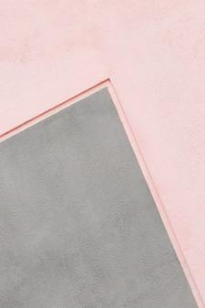 Tło ściany w kolorze szarym i różowym
