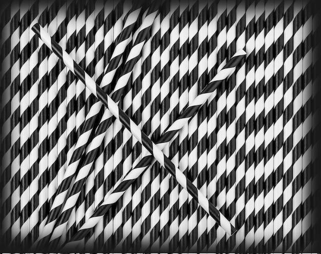 Tło słomek do napojów w paski w czarno-białych kolorach