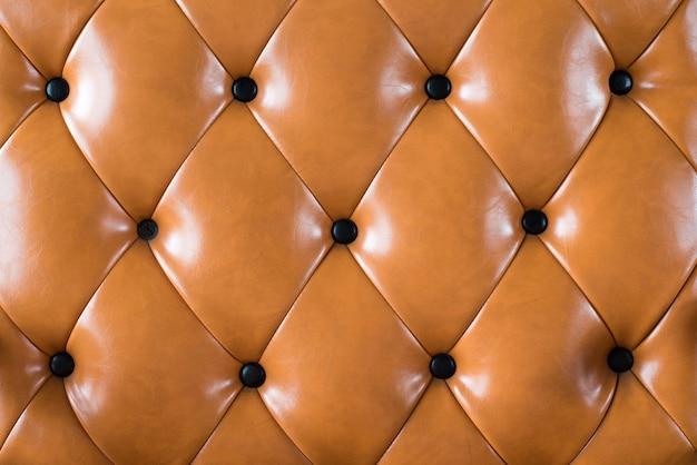 Tło sofa przez lether brązowy