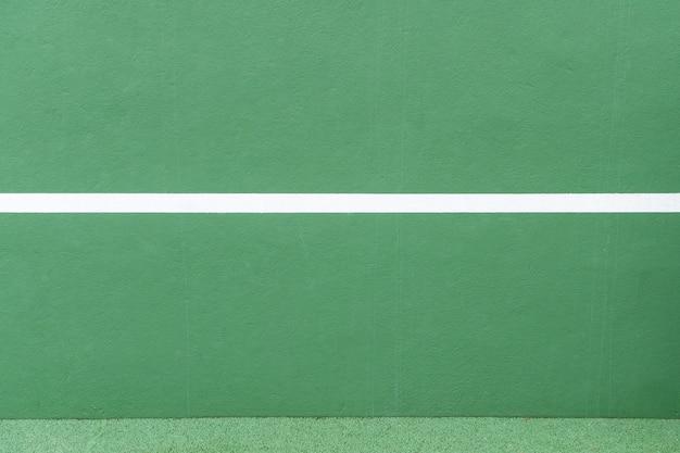 Tło sportowe zielona ściana i biała linia