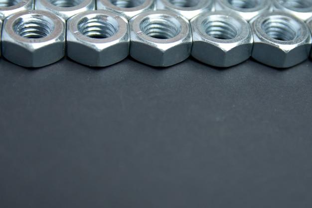 Tło śruby metalowej. skopiuj miejsce na tekst. widok koncepcji metalowej nakrętki.