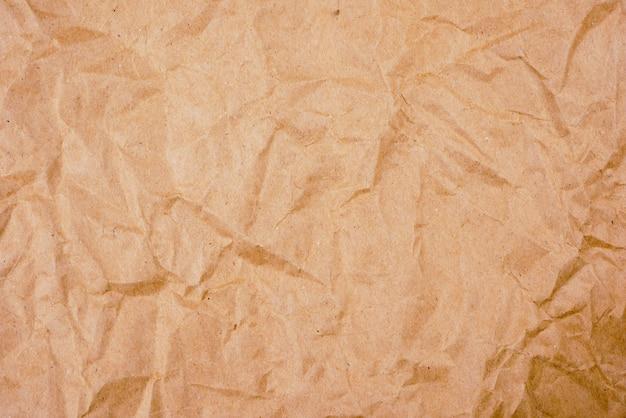 Tło stara brązowa zmięta papierowa tekstura