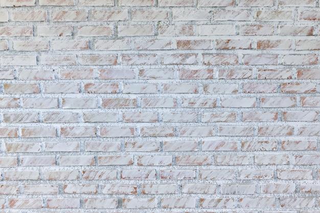 Tło starego rocznika brudny ściana z cegieł z obieranie tynkiem, tekstura