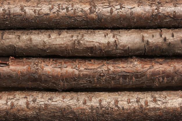 Tło starych drewnianych bali