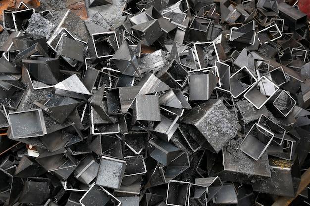 Tło stos kawałków metali ciętych