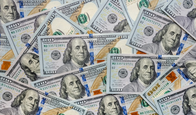 Tło stu dolarowych. dużo amerykańskiej gotówki.