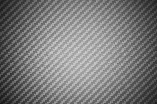 Tło surowego kompozytu z szarego włókna węglowego