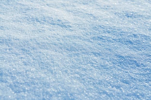 Tło świeża śnieżna tekstura w błękitnym brzmieniu