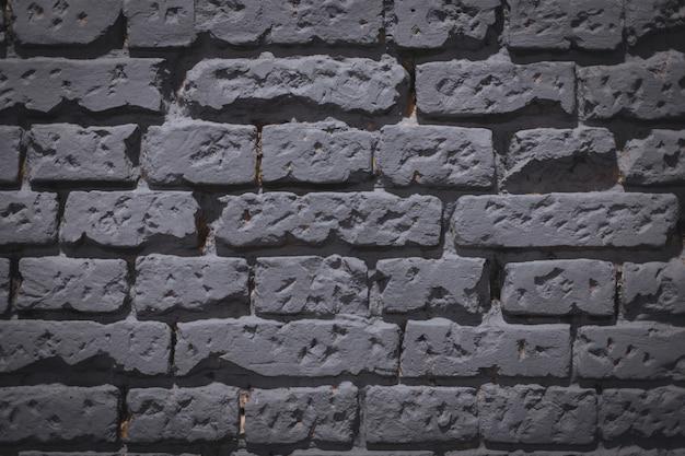 Tło szarego ceglanego muru - świetne na fajne lub tapetę