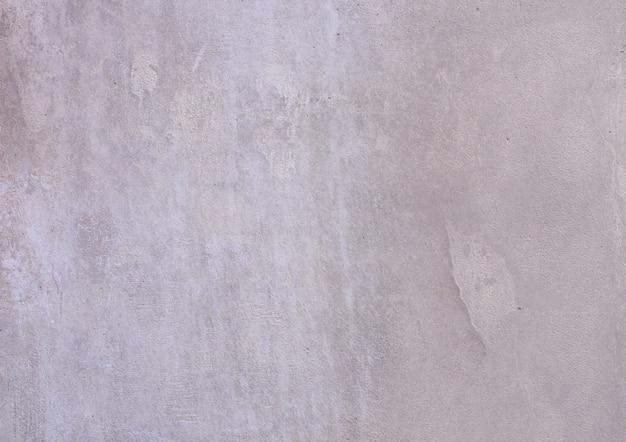 Tło szarej, pokrytej i pomalowanej na zewnątrz stiuku, szorstki odlew cementu i betonowa ściana tekstur