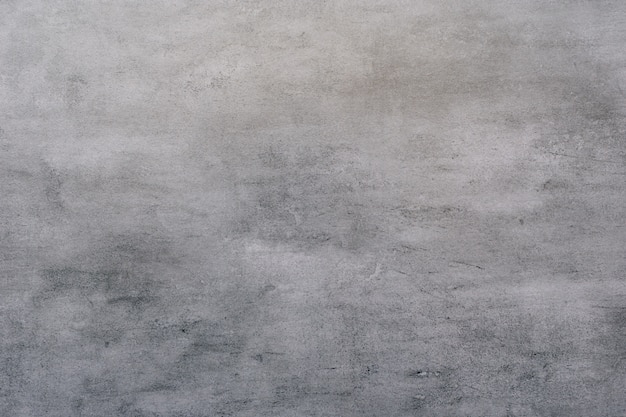 Tło szarej, powleczonej stiukiem i pomalowanej powierzchni