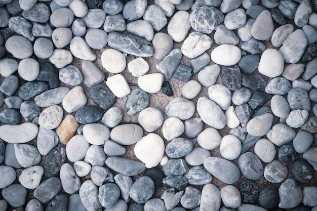 Tło tekstura od koloru małych kamieni otoczaków morza plaży natury tła