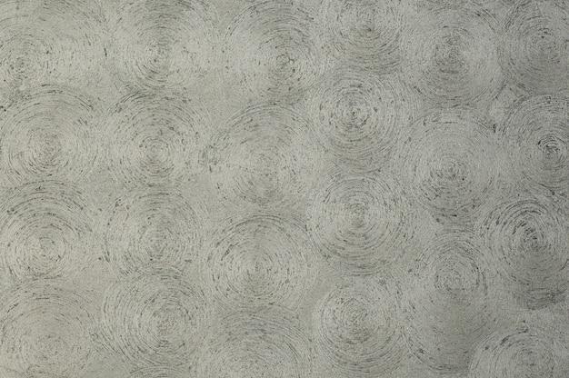 Tło tekstura sztukaterie z okręgami. tło artystyczne ręcznie robione