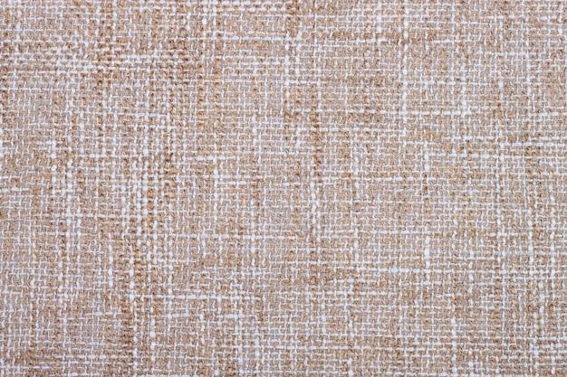 Tło tekstura włókienniczych. zbliżenie beżowej tkaniny