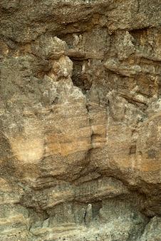 Tło, tekstura - zwietrzała ściana skalna lub ściana jaskini