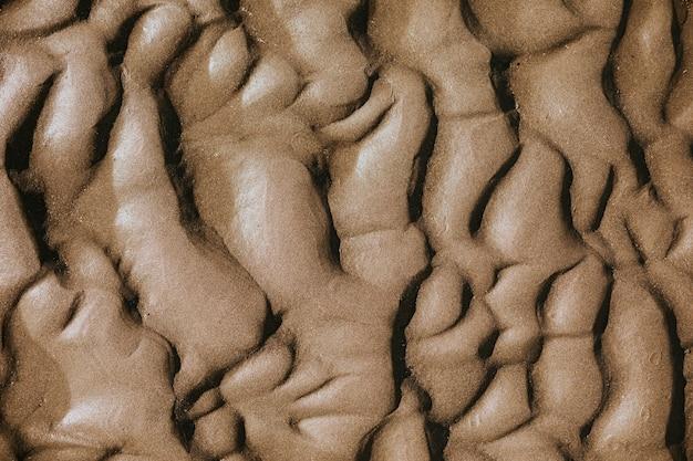 Tło tekstury fali piasku na plaży