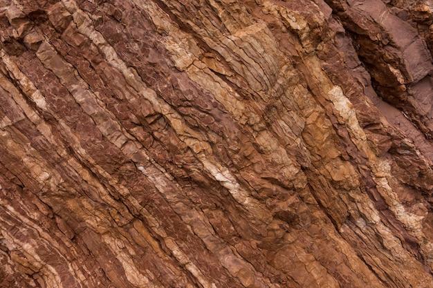 Tło tekstury kamienia w kolorach czerwonym i brązowym