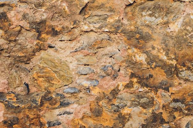 Tło tekstury kamiennego muru.