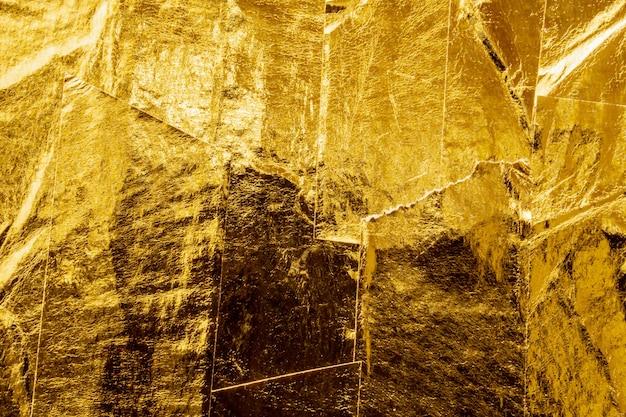 Tło tekstury taśmy złotej folii