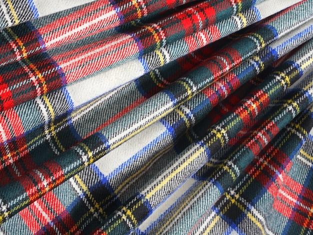 Tło tkaniny wełnianej w szkockiej klatce plisowane. zbliżenie