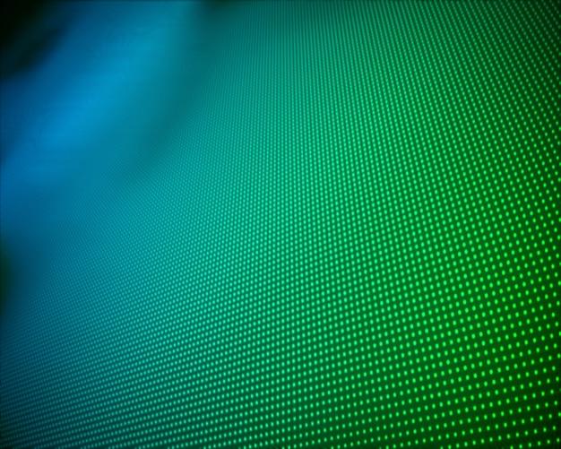 Tło wielu zielonych kropek
