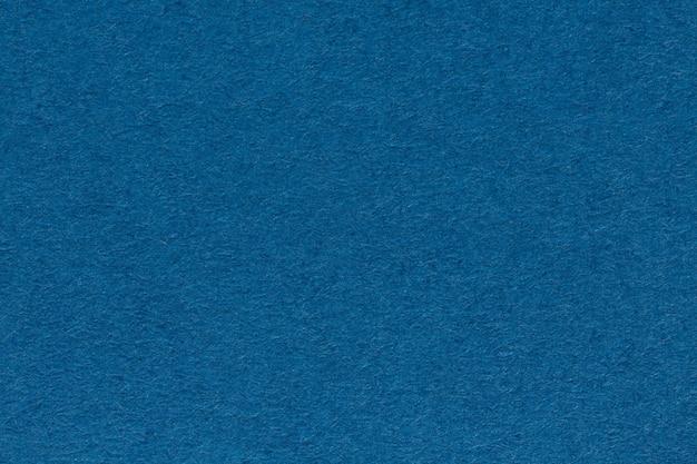 Tło z arkusza ciemnoniebieski kolor papieru z bliska. zdjęcie w wysokiej rozdzielczości.