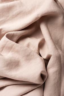 Tło z beżową lnianą tkaniną, widok z góry na dół