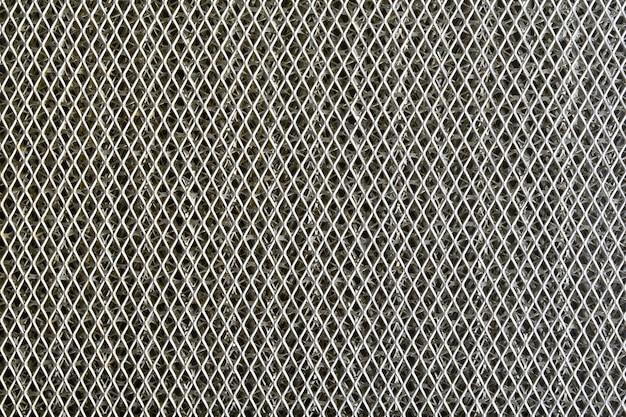 Tło z blachy pokrytej liniami okrągłych otworów