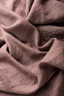 Tło z brązową lnianą tkaniną, widok z góry na dół