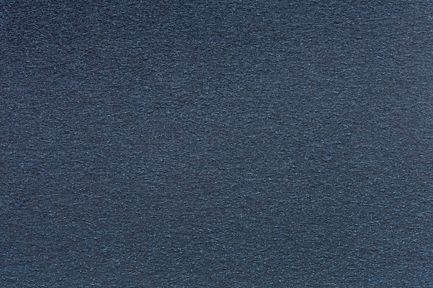 Tło z ciemnoniebieskiego aksamitu. wysokiej jakości tekstura w ekstremalnie wysokiej rozdzielczości