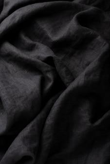 Tło z czarną lnianą tkaniną, widok z góry na dół