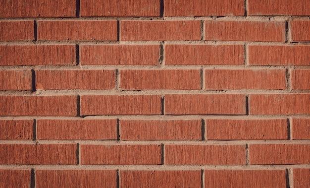 Tło z czerwonej cegły lub tapeta, mocny mur.