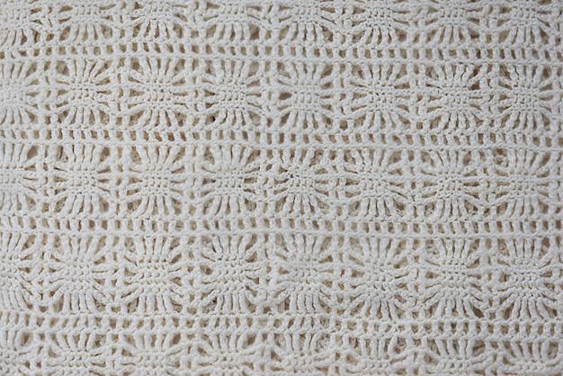 Tło z dzianego ornamentu z białych nici