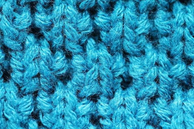 Tło z dzianiny z bliska w kolorze niebieskim
