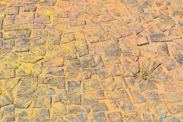 Tło z kolorowego proszku na podłodze