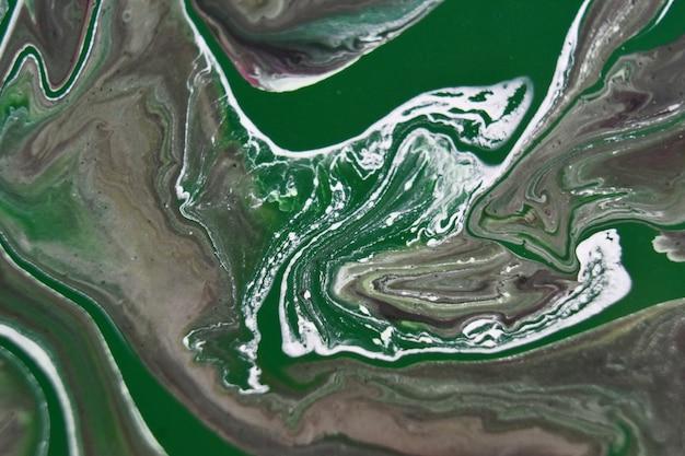 Tło z kolorowymi farbami mieszanymi, abstrakcyjny obraz wylewania