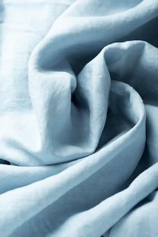 Tło z niebieską lnianą tkaniną, widok z góry na dół