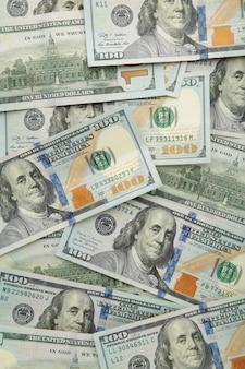 Tło z pieniędzy amerykańskich stu dolarowych