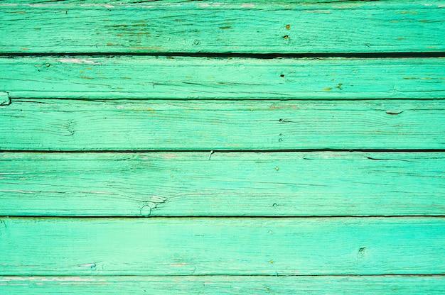Tło z poziomych desek pomalowane na zielono. abstrakcyjne tło.