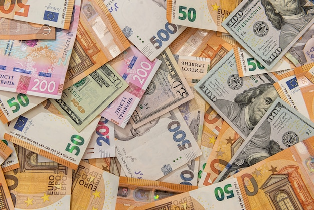 Tło z różnych pieniędzy, euro i dolarów hrywny