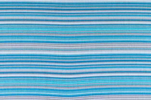 Tło z tkaniny w paski w kolorze niebieskim, białym i szarym