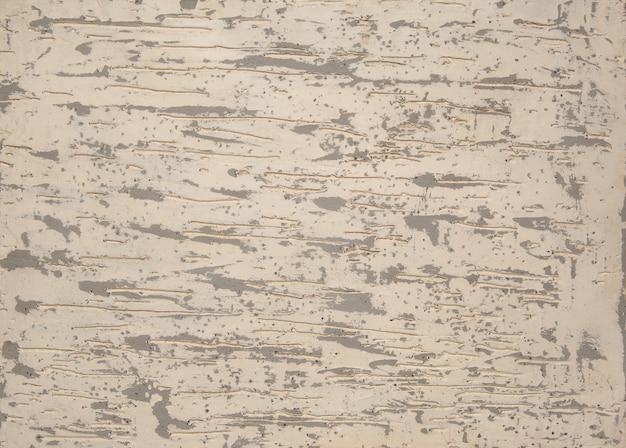Tło z tynku strukturalnego z żyłkami koloru beżowego. tło sztuki