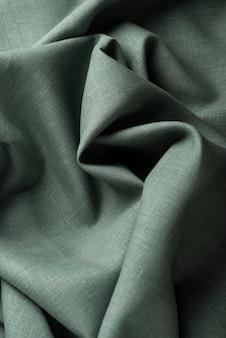 Tło z zieloną lnianą tkaniną, widok z góry na dół