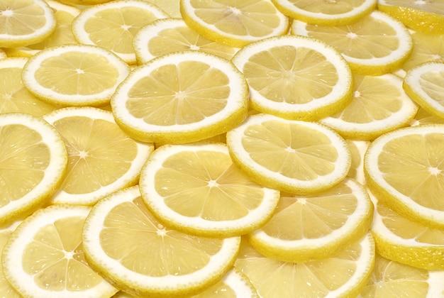 Tło zbliżenie plasterki cytryny