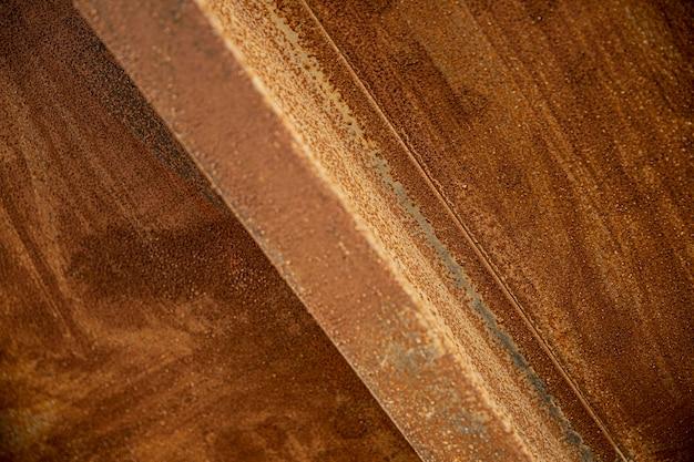 Tło zbliżenie przemysłowe brązowej stali