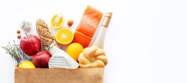 Tło zdrowej żywności zdrowa żywność z owocami i warzywami koncepcja żywności w supermarkecie wino