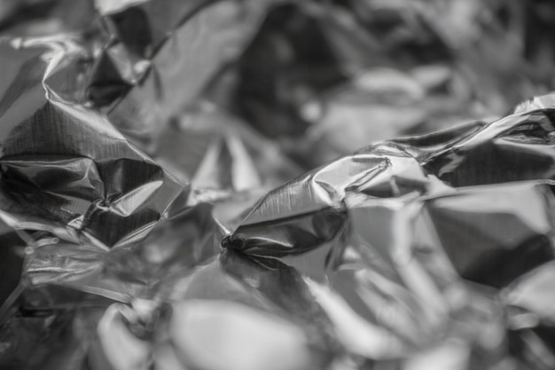 Tło zgniecionej folii srebrnej folia tekstury