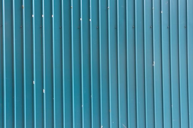 Tło zielony cynkowy ogrodzenie