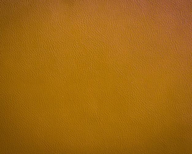 Tło zielony skórzany pomarańczowy