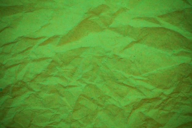 Tło zielony zmięty papier.